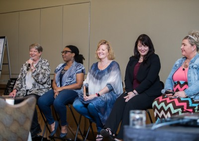 Five women talk on a panel at Women Who Test
